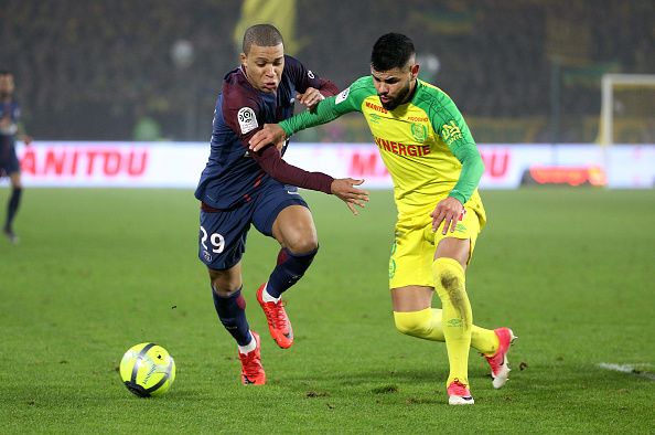 NANTES, FRANCE - JANUARY 14: Kylian Mbappe of PSG, Lucas Lima of FC Nantes during the French Ligue 1 match between FC Nantes and Paris Saint Germain (PSG) at Stade de la Beaujoire on January 14, 2018 in Nantes, France. (Photo by Jean Catuffe/Getty Images)